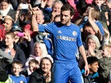 Chelsea's Juan Mata celebrates scoring the opener in the FA Cup 4th round replay against Brentford on February 17, 2013