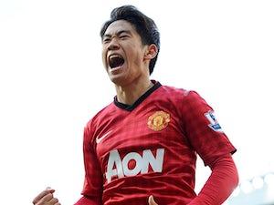 Manchester United's Shinji Kagawa celebrates scoring his third goal against Norwich on March 2, 2013