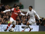 Arsenal's Santi Cazorla takes on Aaron Lennon of Spurs on March 3, 2013