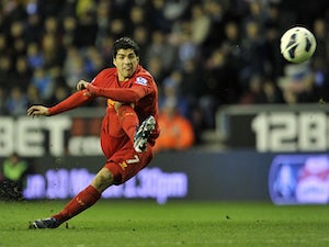 Liverpool's Luis Suarez scores from a free kick against Wigan on March 2, 2013
