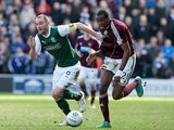 Hearts' Michael Ngoo and Hibernian's James McPake battle for the ball on March 10, 2013