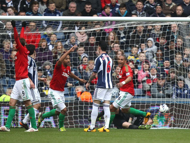 Swansea City's Luke Moore celebrates scoring the opening goal of the game against West Brom on March 9, 2013