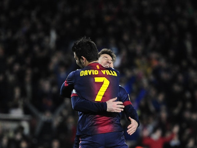 Barca forward David Villa hugs Lionel Messi after the Spaniard scored against Rayo Vallecano on March 17, 2013