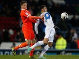 Millwall's Shane Lowry and Blackburn's Leon Best battle for the ball during their FA Cup quarter final clash on March 13, 2013