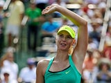 Maria Sharapova waves after beating Elena Vesnina in the third round at the Miami Masters on March 24, 2013
