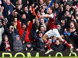 Andy Carroll celebrates after scoring the opening goal against West Brom on March 30, 2013