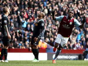 Aston Villa's Christian Benteke celebrates scoring against Liverpool in the Premier League clash on March 31, 2013