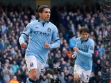 Carlos Tevez celebrates scoring the opening goal against Newcastle on March 30, 2013