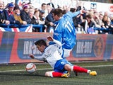Rangers' Ian Black and Montrose's Scott Johnston battles for the ball on March 30, 2013