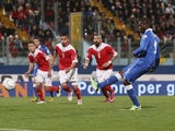 Italy striker Mario Balotelli dispatches a penalty against Malta on March 26, 2013