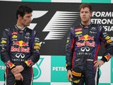 Red Bull drivers Webber and Vettel on the podium after the Malaysian GP on March 24, 2013
