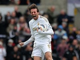 Michu celebrates moments after grabbing a goal back against Spurs on March 30, 2013