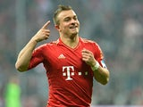 Munich's Xherdan Shaqiri celebrates after scoring his team's first against Hamburger SV on March 30, 2013