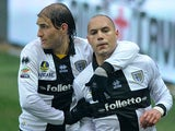 Parma's Yohan Benalouane is congratulated by team mate Gabriel Paletta after scoring the opening goal against Pescara on March 30, 2013