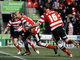 Doncaster Rovers' Rob Jones celebrates scoring against Tranmere on April 6, 2013