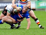 Wakefield Wildcat's Justin Poore is tackled during his side's match against the Bradford Bulls on February 3, 2013