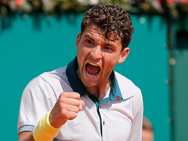 Grigor Dimitrov celebrates after defeating Janko Tipsrevic in the Monte Carlo Masters on April 16, 2013
