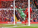 Liverpool's Pepe Reina fails to stop Chelsea's Oscar from scoring the first goal in the Premier League clash on April 21, 2013