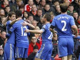 Goalscorer Oscar celebrates with his Chelsea teammates after giving his side the lead in the match against Liverpool on April 21, 2013