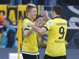 Dortmund striker Marco Reus is congratulated after scoring against Mainz on April 20, 2013