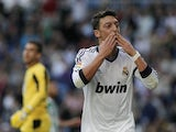 Real Madrid's Mesut Ozil celebrates a goal against Real Betis on April 20, 2013