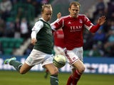 Hibernian's Leigh Griffiths holds off Aberdeen's Ryan Jack during the Scottish Premier League match on April 22, 2013
