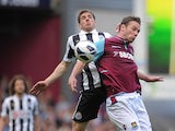 Dan Gosling and Kevin Nolan battle for the ball on May 4, 2013