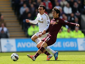David Silva and Leon Britton battle for the ball on May 4, 2013
