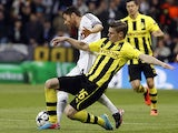 Dortmund's Lukasz Piszczek and Real's Xabi Alonso battle for the ball on April 30, 2013