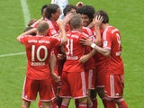 Bayern players celebrate scoring against Augsburg on May 11, 2013