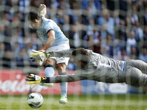 Manchester City's Carlos Tevez tries to score during the FA Cup Final on May 11, 2013