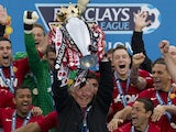 Manchester United manager Alex Ferguson lifts the Premier League trophy on May 12, 2013