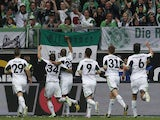 Wolfsburg players celebrate scoring against Borussia Dortmund in the Bundesliga match on May 11, 2103
