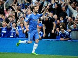 Chelsea's Juan Mata celebrates scoring the first goal of the Premier League encounter with Everton on May 19, 2013