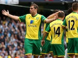 Norwich City's Grant Holt celebrates scoring against Manchester City on May 19, 2013