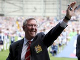 Manchester United manager Sir Alex Ferguson salutes the fans prior the the match against West Brom on May 19, 2013
