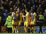 Crystal Palace's Wilfried Zaha is congratulated by team mates after scoring the opening goal against Brighton on May 13, 2013