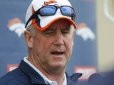 Denver Broncos head coach John Fox talks to reporters on May 20, 2013