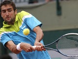 Marin Cilic returns the ball to Nick Kyrgios during their second round match of the French Open on May 29, 2013