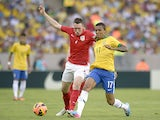 England's Phil Jones and Brazil's Luis Gustavo Dias battle for the ball during a friendly match on June 2, 2013