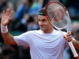 Roger Federer celebrates after defeating Gille Simon during their fourth round match of the French Open on June 2, 2013