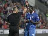 Italy's Mario Balotelli receives the red card from referee Svein Oddvar Moen during the World Cup qualifying match against the Czech Republic on June 7, 2013