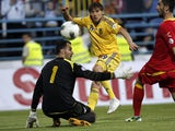 Ukraine's Denys Garmash scores past Montenegro's goalkeeper Mladen Bozovic during their World Cup qualifying match on June 7, 2013