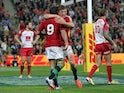 Lions' Owen Farrell and Ben Youngs celebrate a try against Queensland Reds on June 8, 2013