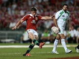 Lions' Owen Farrell kicks during the game with the Barbarians on June 1, 2013