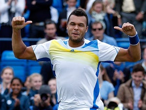 Jo-Wilfried Tsonga celebrates after beating opponent Denis Kudla during their quarter final match at Queens on June 14, 2013