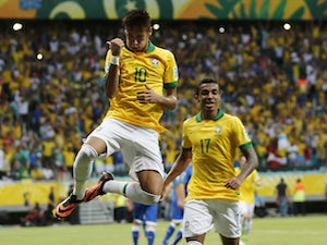 Brazil's Neymar celebrates scoring his side's 2nd goal during the Confederations Cup match against Italy on June 22, 2013