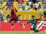 Spain's Fernando Torres scores a goal against Tahiti on June 20, 2013