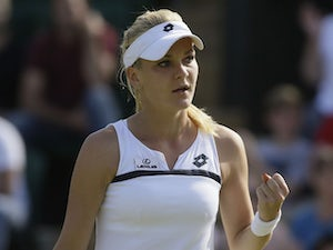 Agnieszka Radwanska of Poland reacts after winning a point against Madison Keys of United States during their Women's singles match on June 29, 2013