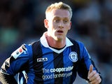 Rochdale's Ashley Grimes in action against Burnley on August 7, 2012